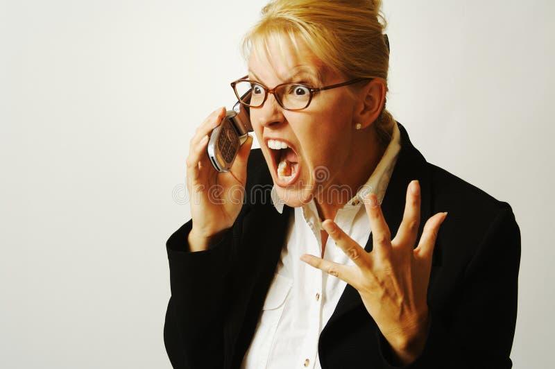 Geschäftsfrau verärgert auf dem Cer stockfoto