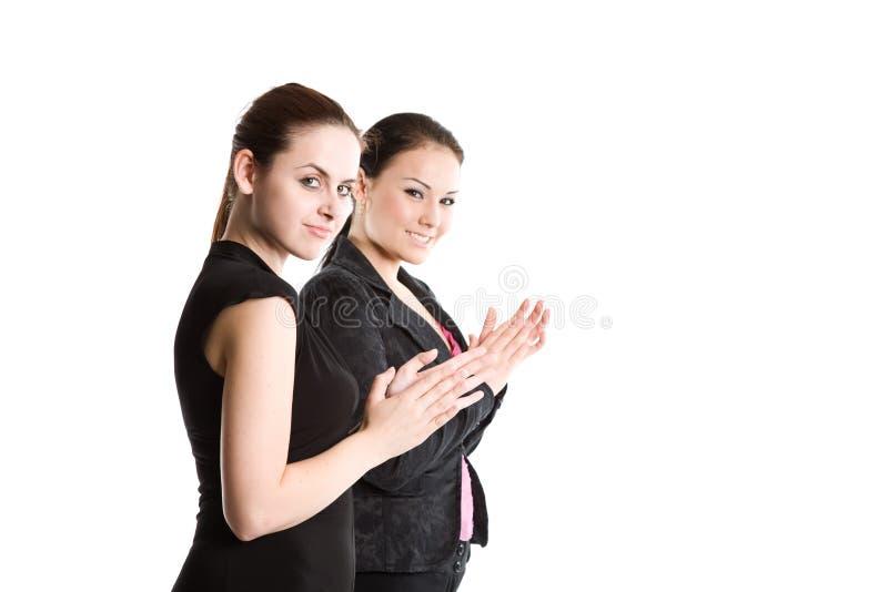 Geschäftsfrauen, die Hände klatschen lizenzfreie stockfotografie