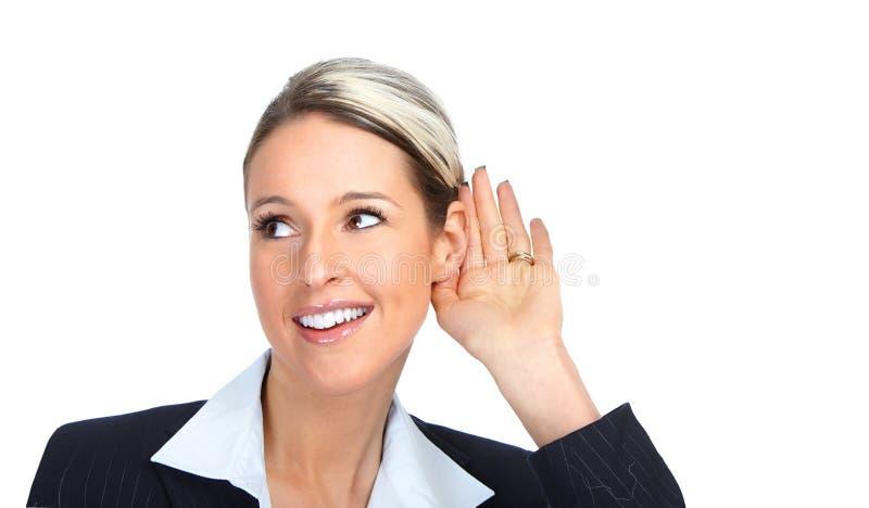 Geschäftsfrauhören lizenzfreie stockbilder