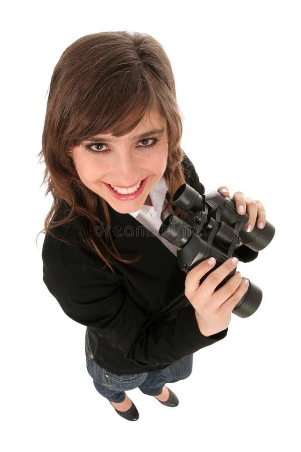 Geschäftsfrauholdingbinokel lizenzfreie stockfotografie