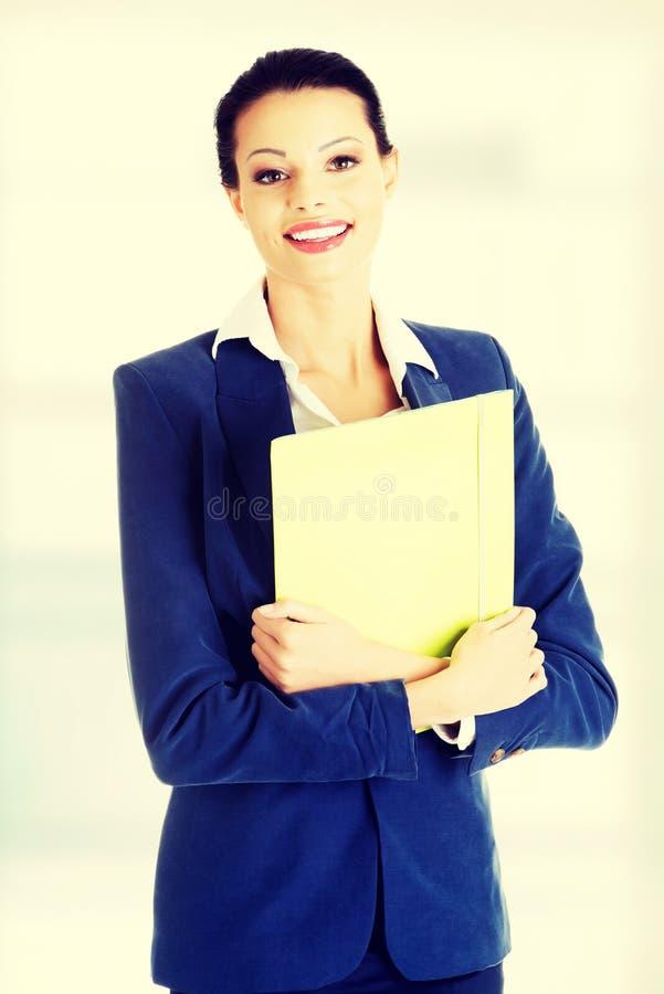 Geschäftsfrauholdingdateien lizenzfreies stockfoto