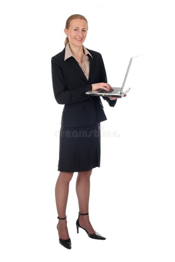 Geschäftsfrauholdinglaptop stockbild
