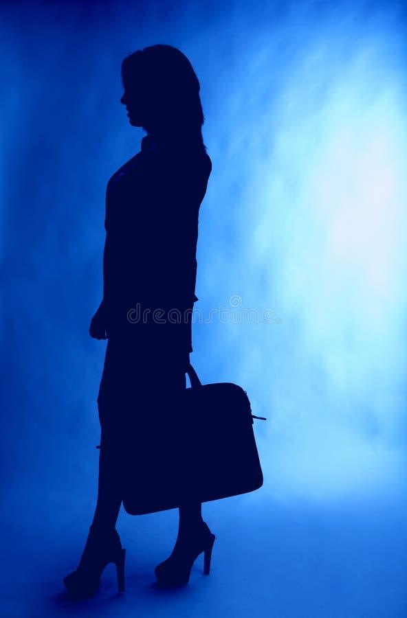 Geschäftsfrauschattenbild mit Aktenkoffer stockbild