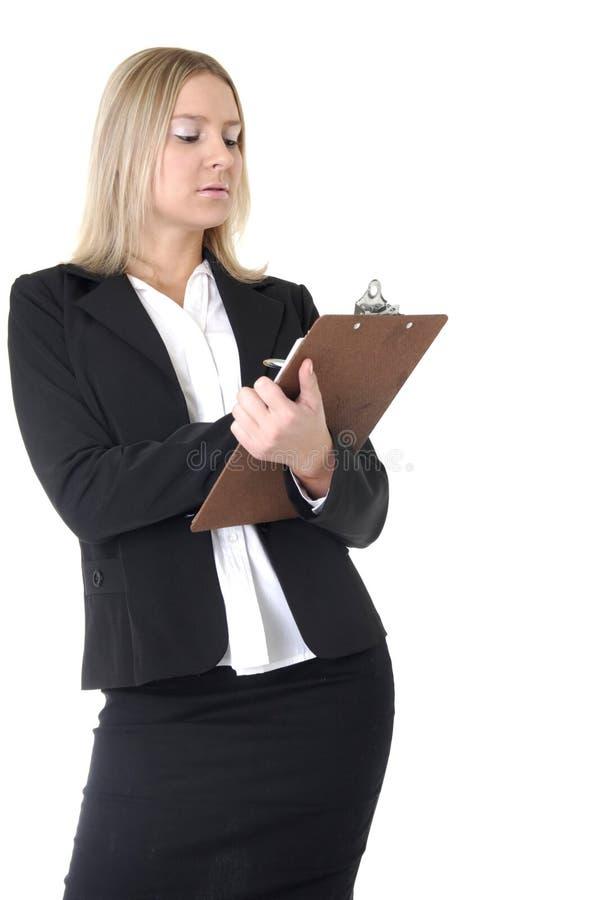 Geschäftsfrauschreiben im Diagramm lizenzfreie stockbilder