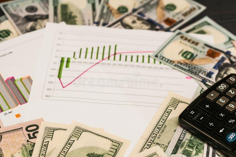 Geschäftskonzept - Grafikdiagrammdollartaschenrechnerfinanzierung lizenzfreies stockfoto