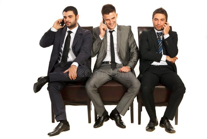 Geschäftsleute an den Telefonen stockbilder