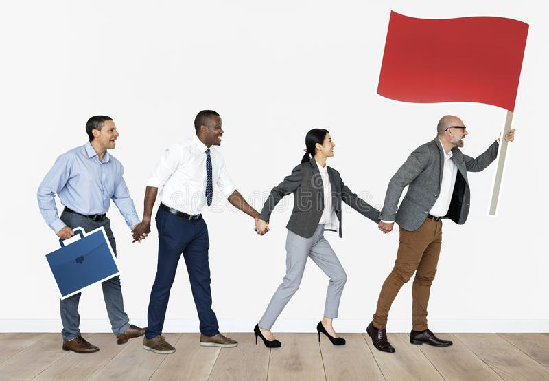 Geschäftsleute, die ihrem Führer folgen lizenzfreie stockbilder