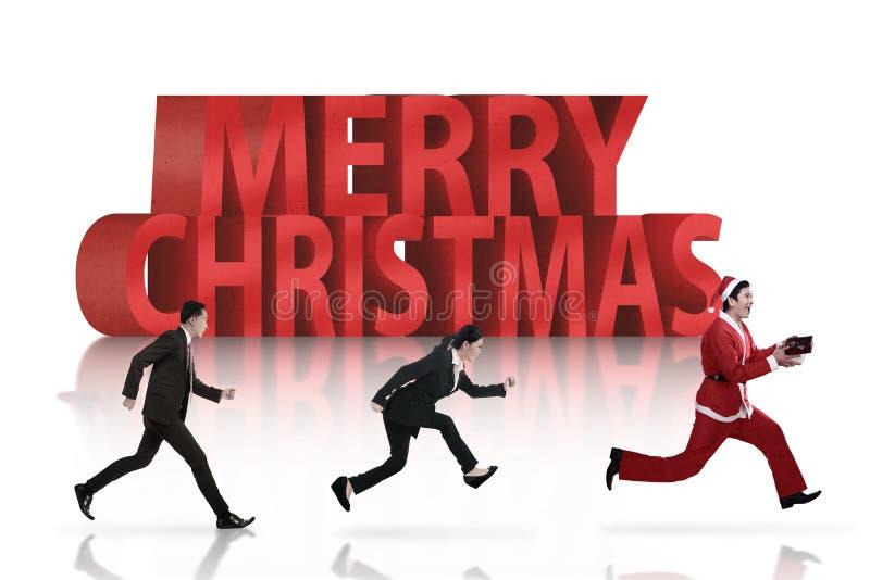 Geschäftsleute, die Weihnachtsmann jagen vektor abbildung