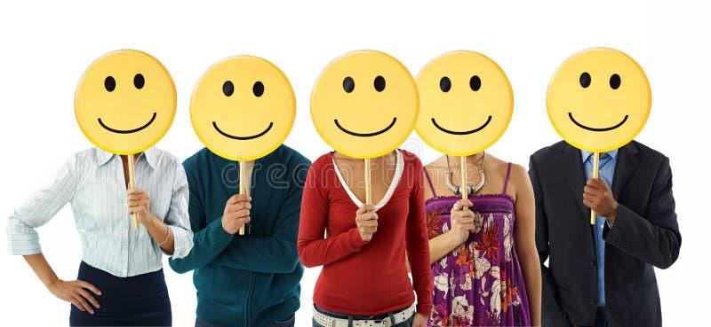 Geschäftsleute mit Emoticon lizenzfreies stockfoto