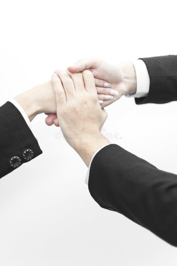 Geschäftsleute mit Handdem überlappen lizenzfreies stockfoto