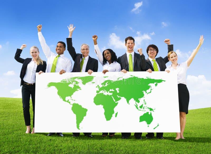 Geschäftsleute mit Welterfolg lizenzfreie stockbilder