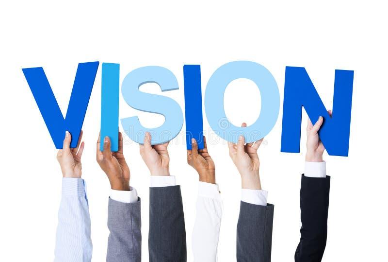 Geschäftsleute, welche die Wort-Vision halten stockfotos