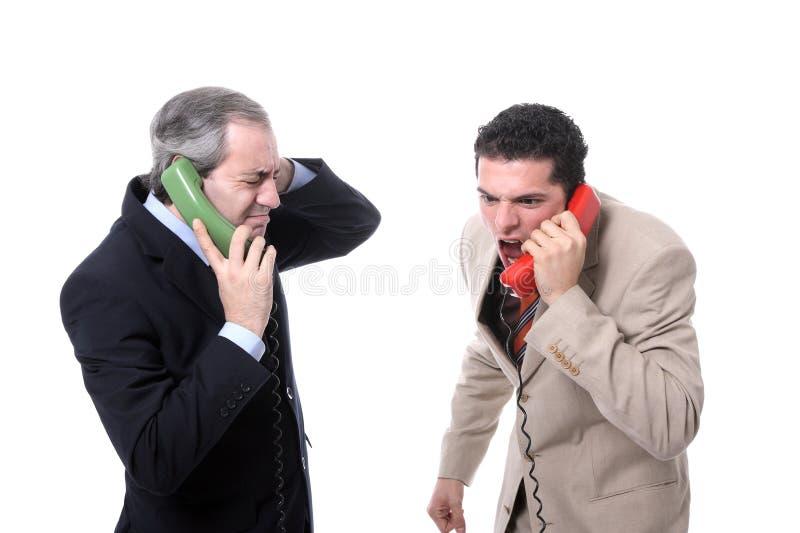 Geschäftsmänner, Die Am Telefon Schreien Stockbilder