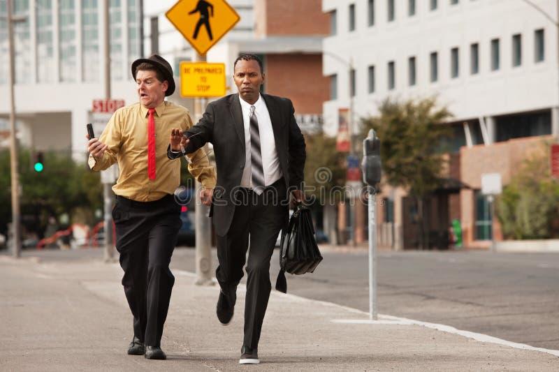 Geschäftsmänner in einer Hast stockfoto