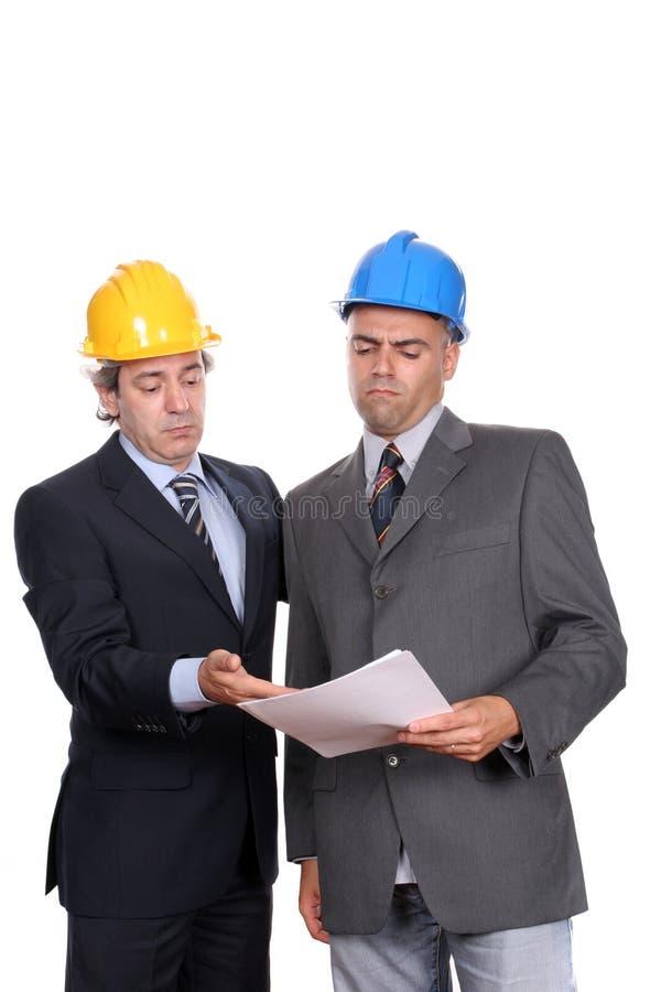 Geschäftsmänner in einer Sitzung, neues Projekt behandelnd lizenzfreie stockbilder