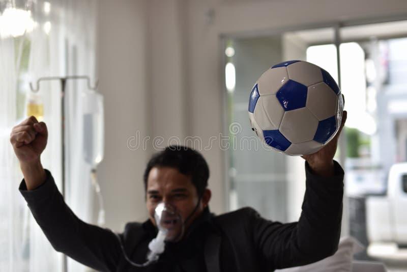 Geschäftsmänner haben noch einen Beifall für Fußball stockfoto