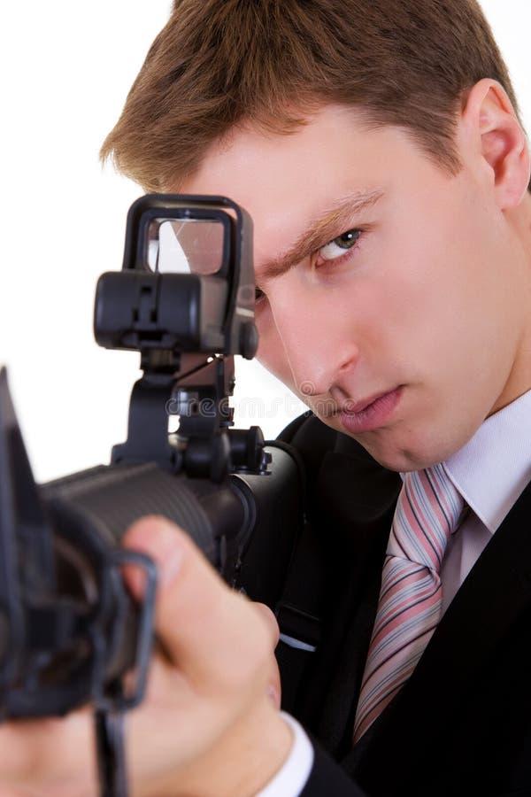 Geschäftsmanmann mit Gewehr. lizenzfreie stockfotos