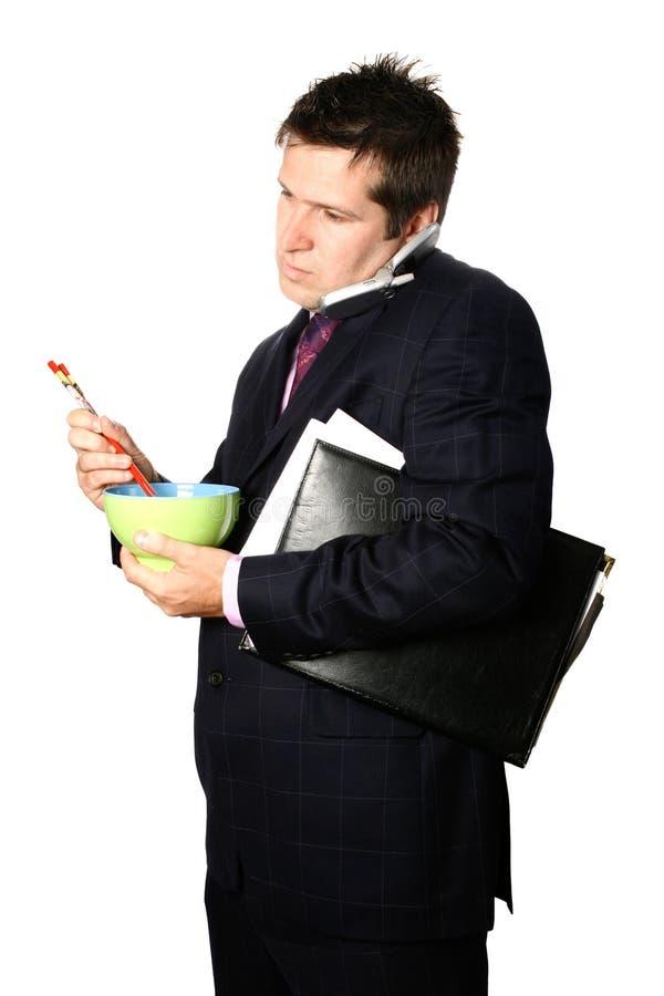 Geschäftsmann auf Handy lizenzfreie stockfotografie