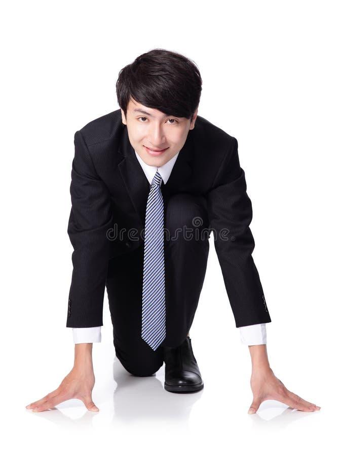 Geschäftsmann betriebsbereit zu laufen zu beginnen stockbild