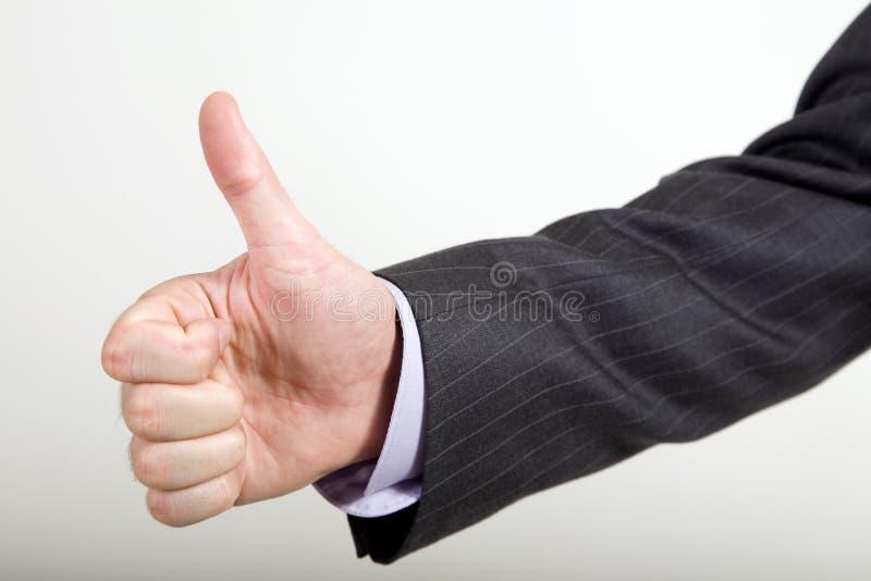 Geschäftsmann bietet Thumbs-Up an lizenzfreie stockbilder