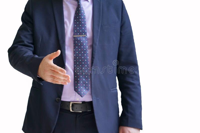 Geschäftsmann dehnt heraus seine Hand aus lizenzfreie stockfotografie