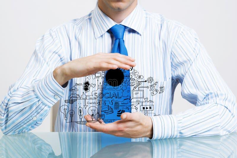 Geschäftsmann demonstrieren seinen Unternehmensplan lizenzfreies stockbild