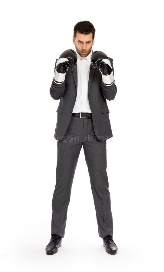 Geschäftsmann in den Boxhandschuhen lizenzfreie stockbilder