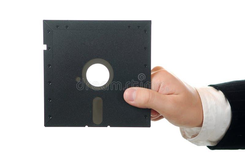 Geschäftsmann, der alten Floppy-Disc anhält stockfotos