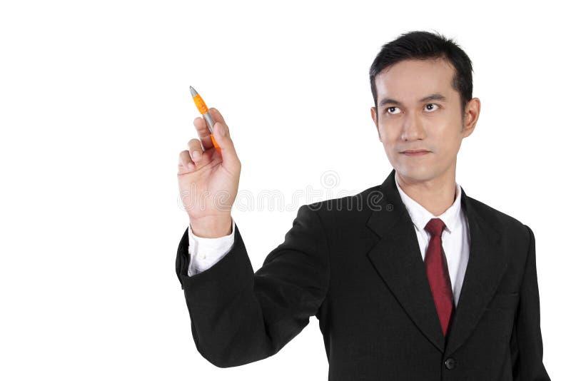 Geschäftsmann, der auf copyspace mit dem Stift, lokalisiert auf Weiß zeigt lizenzfreies stockfoto
