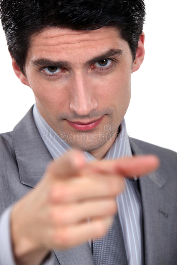 Geschäftsmann, der auf Sie zeigt stockfotografie