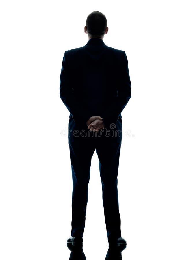 Geschäftsmann, der die hintere Ansicht lokalisiert steht stockfotografie