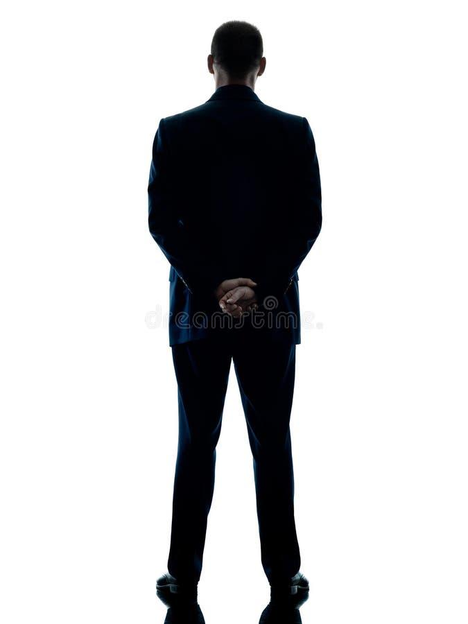 Geschäftsmann, der die hintere Ansicht lokalisiert steht stockbilder