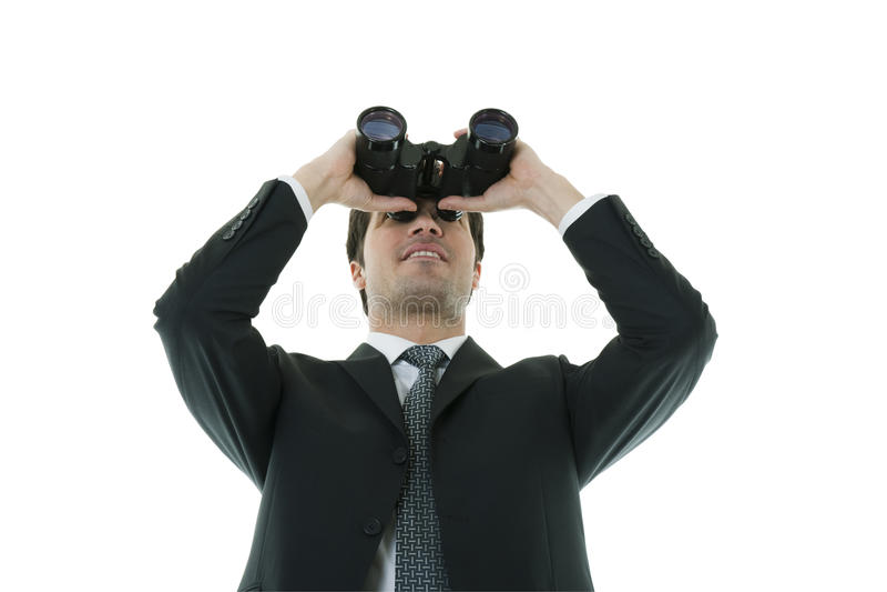 Geschäftsmann, der durch Binokel schaut lizenzfreie stockfotos