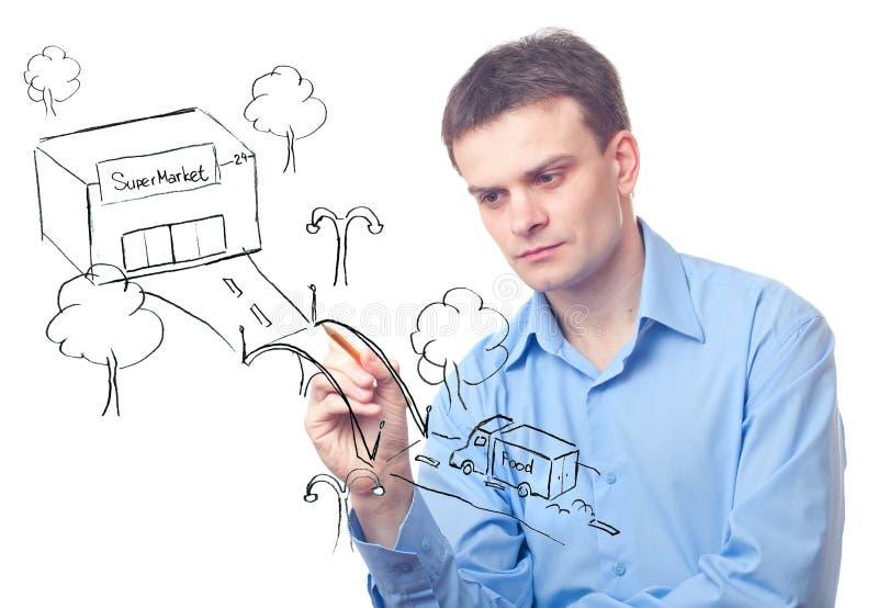 Geschäftsmann, der eine Brücke zeichnet lizenzfreie stockfotos