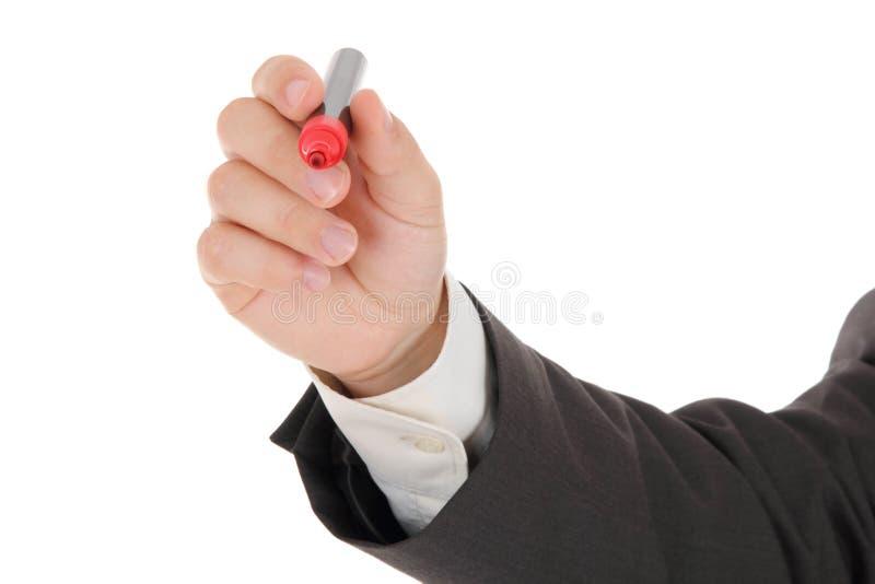 Geschäftsmann, der eine rote Feder anhält lizenzfreies stockbild