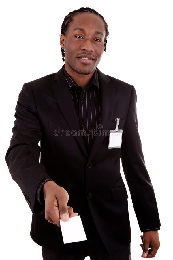 Geschäftsmann, der eine Visitenkarte gibt lizenzfreies stockbild