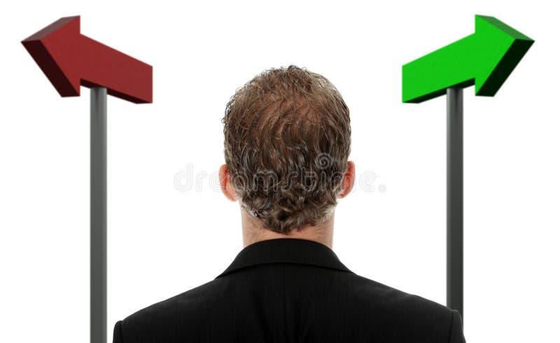 Geschäftsmann, der eine Wahl trifft stockfotos