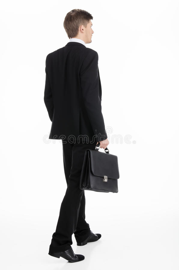 Geschäftsmann, der einen Aktenkoffer trägt stockfotografie