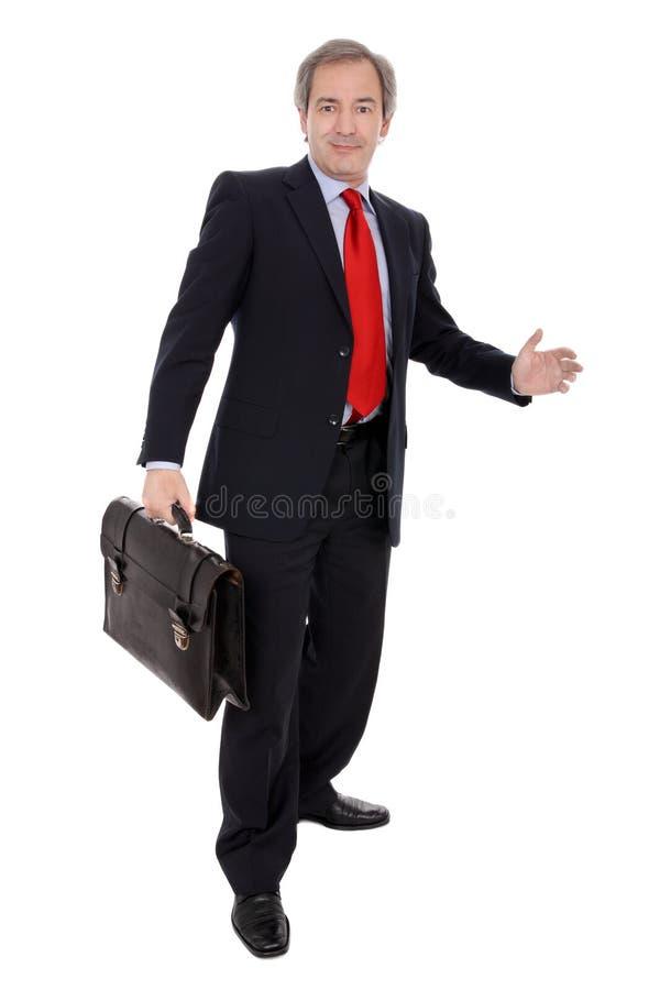 Geschäftsmann, der einen Aktenkoffer trägt stockbilder