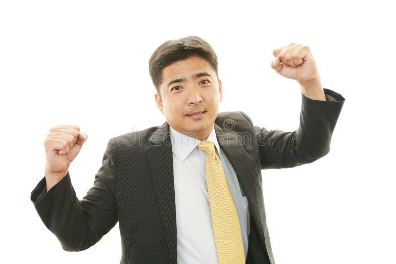Geschäftsmann, der Erfolg genießt stockbild
