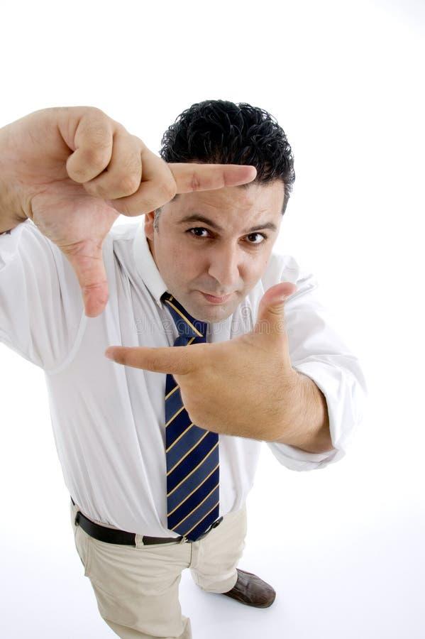 Geschäftsmann, der Geste verweisend darstellt lizenzfreie stockbilder