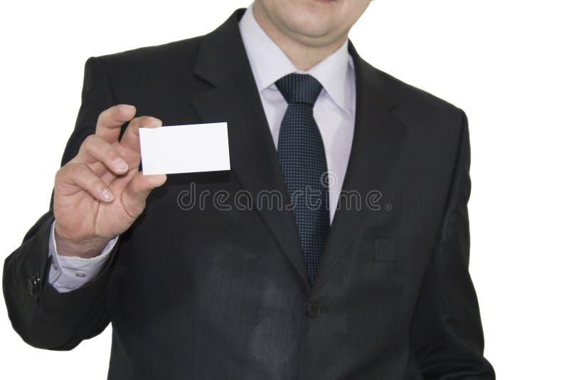 Geschäftsmann, der heraus f schaut stockbild
