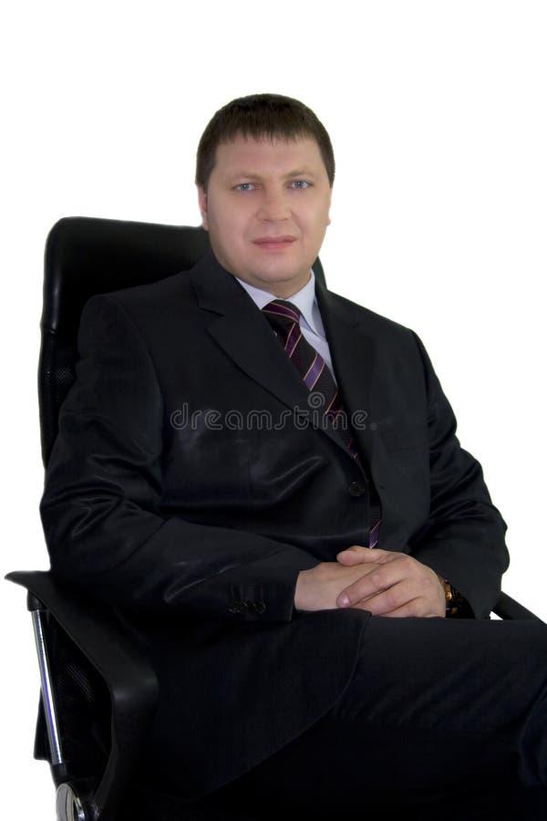 Geschäftsmann, der im Stuhl sitzt stockbilder