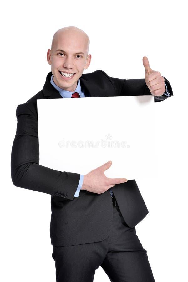 Geschäftsmann, der leeres Zeichen zeigt stockbild