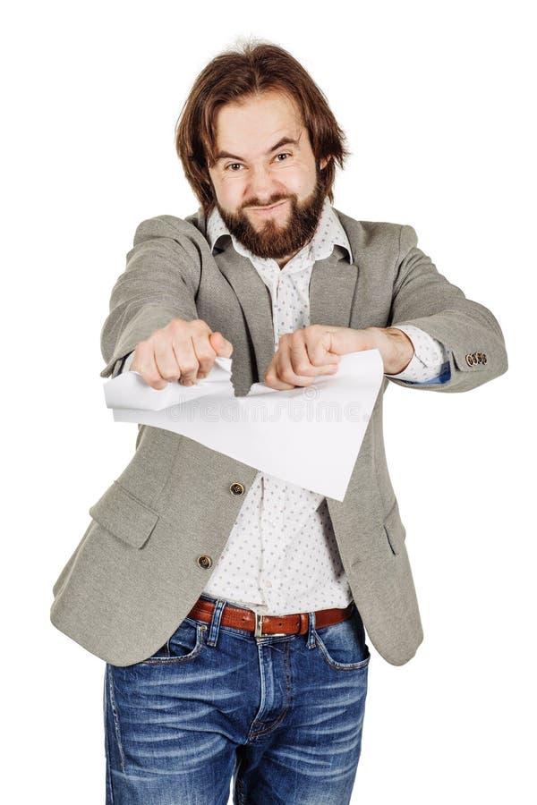 Geschäftsmann, der oben einen Vertrag oder eine Vereinbarung zerreißt lizenzfreie stockfotografie