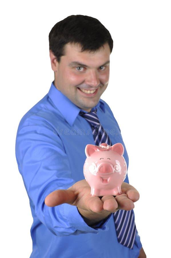 Geschäftsmann, der piggy Querneigung anhält stockfoto