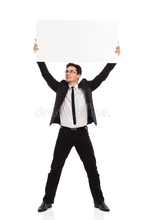 Geschäftsmann, der Plakat über seinem Kopf hält. stockbilder