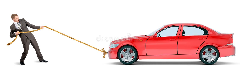 Geschäftsmann, der rotes Auto zieht lizenzfreie stockfotos