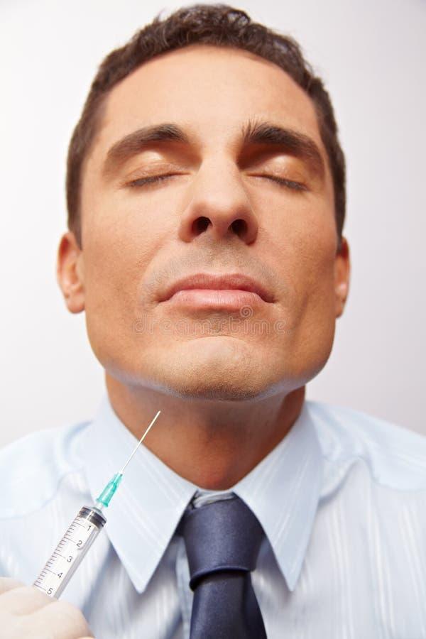 Geschäftsmann, der Schönheitschirurgie erhält lizenzfreie stockbilder