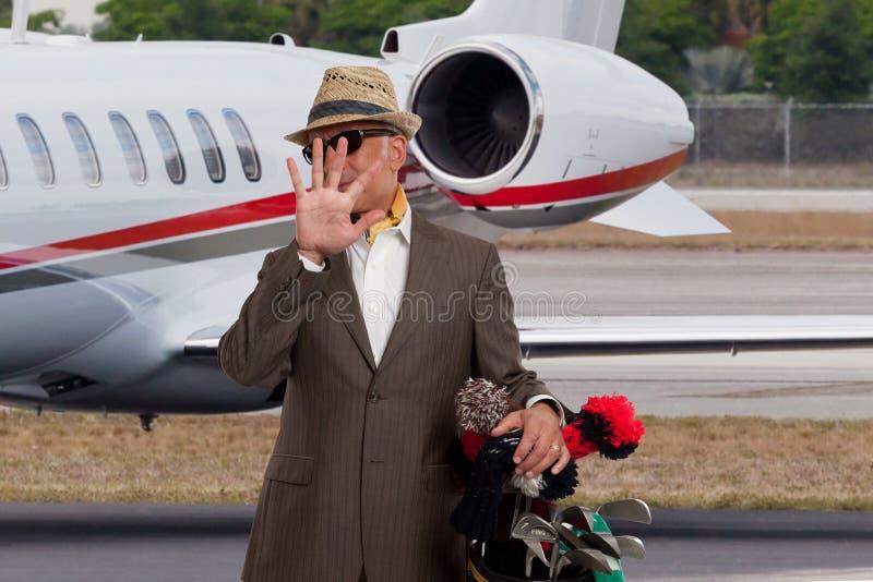 Geschäftsmann, der sein Gesicht abschirmt lizenzfreies stockbild